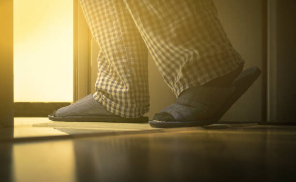 adult man in pijamas walks to a bathroom at the night. men's healths concept. toned - old man feet stock photos and pictures