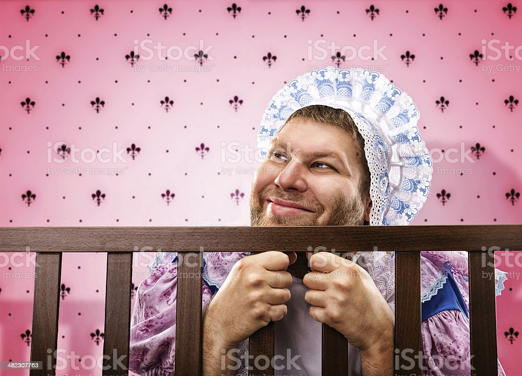 Adult man in playpen looking out stock photo