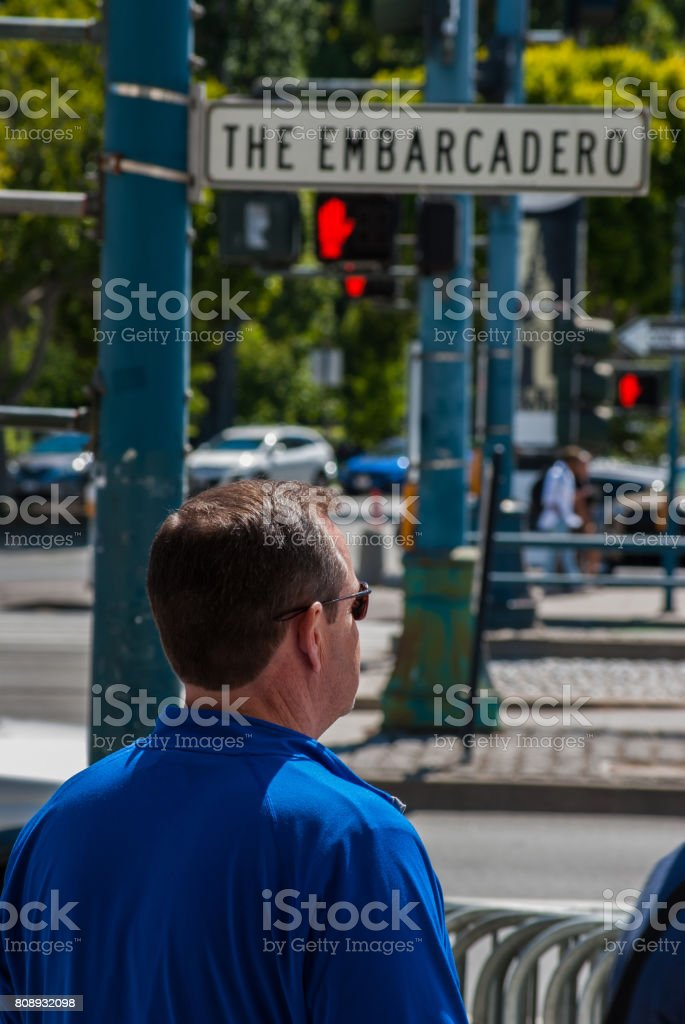 Adult Man Looking with Street Sign Above-San Francisco stock photo