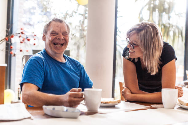 Adult Man Portrait with a Down Syndrome and a Caregiver - foto de acervo