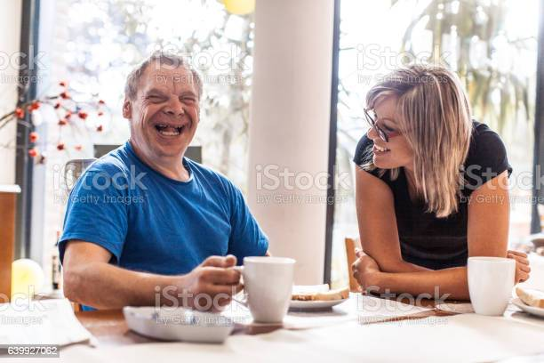 Adult Man Portrait with a Down Syndrome in a Daycare Center
