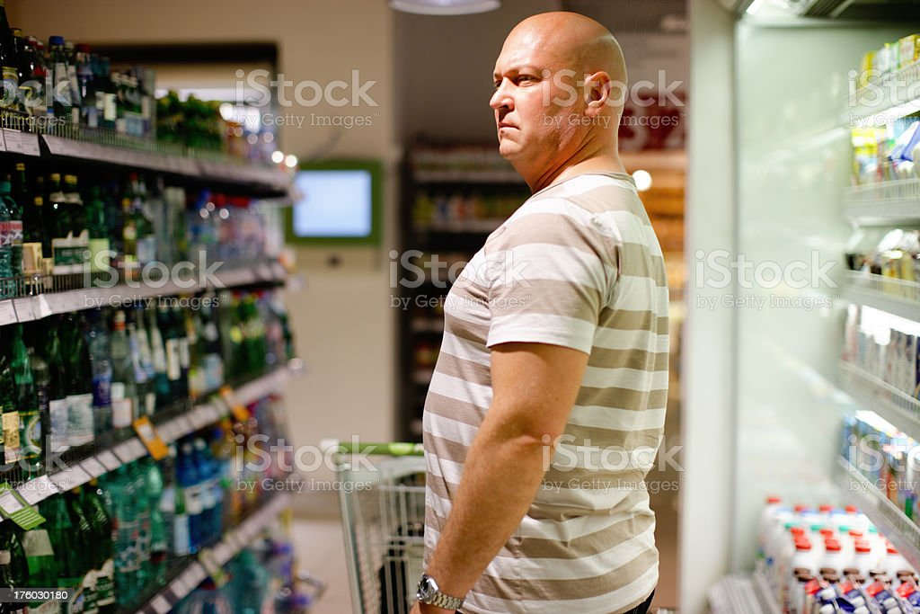 Adult Man shopping in food store royalty-free stock photo
