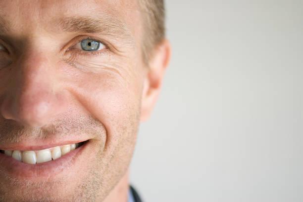 Adult Man Smiling Face Close-Up Blue Eyes Horizontal stock photo