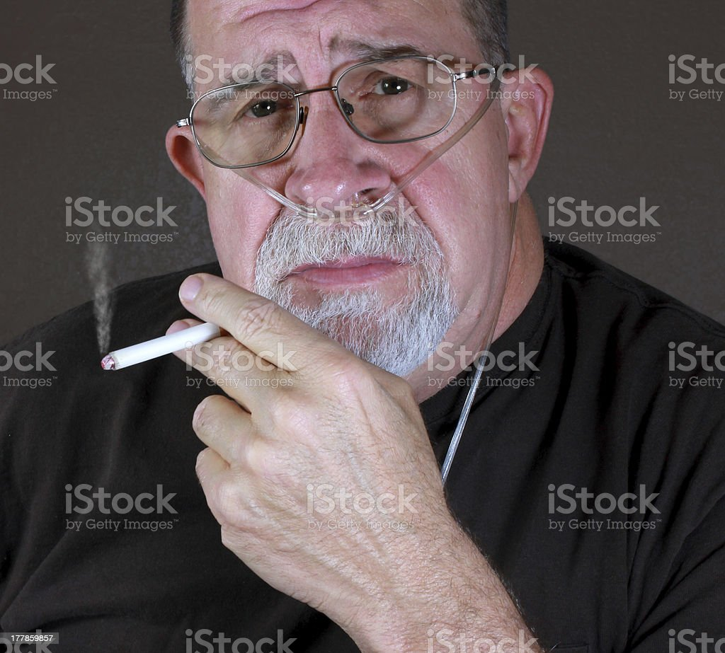 Adult Man Smoking with Cannula stock photo