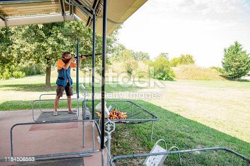 Adult Man Standing on Firing Lane and Practicing Skeet Shooting.