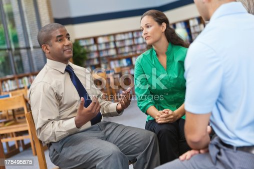 istock Adult man talking in a discussion group 175495875