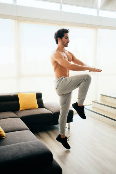Adult Man Training ABS and Legs Doing High Knee Tap stock photo
