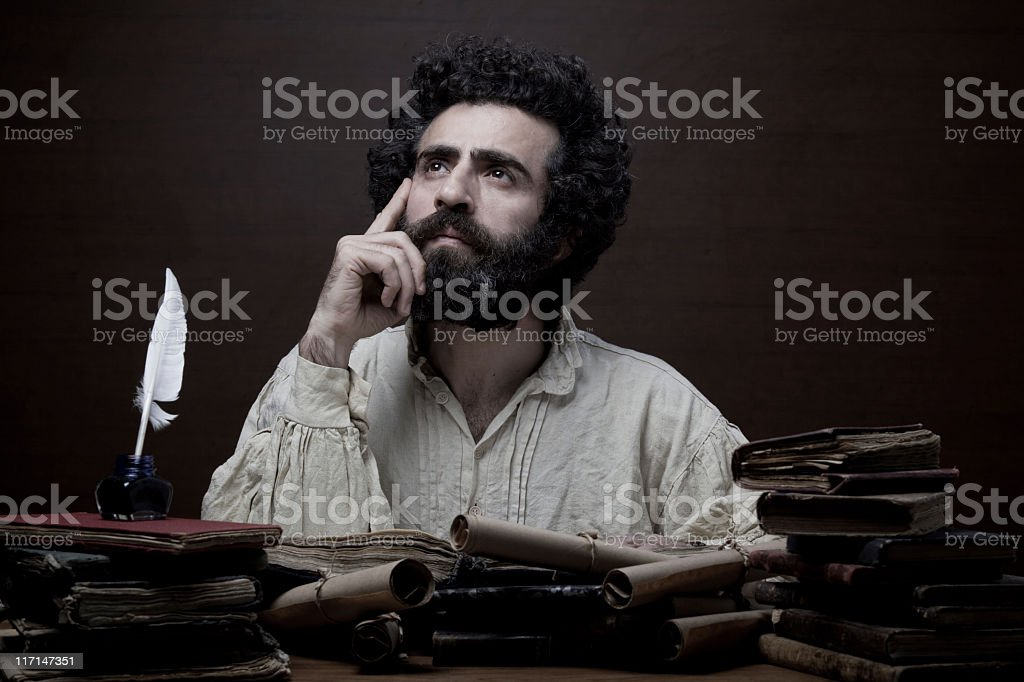 Adult man with beard in Medieval costume thinking for inspiration stock photo