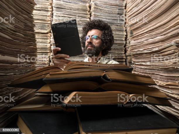 Adult man with dark hair reading book in printed media archive picture id839900080?b=1&k=6&m=839900080&s=612x612&h=hweuquzcurkgkseinecj1nmhouou0nlqakc4emkcqde=