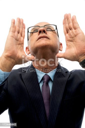 805011368 istock photo A adult man with glasses looks up with hands in the air 172448443
