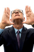 istock A adult man with glasses looks up with hands in the air 172448443