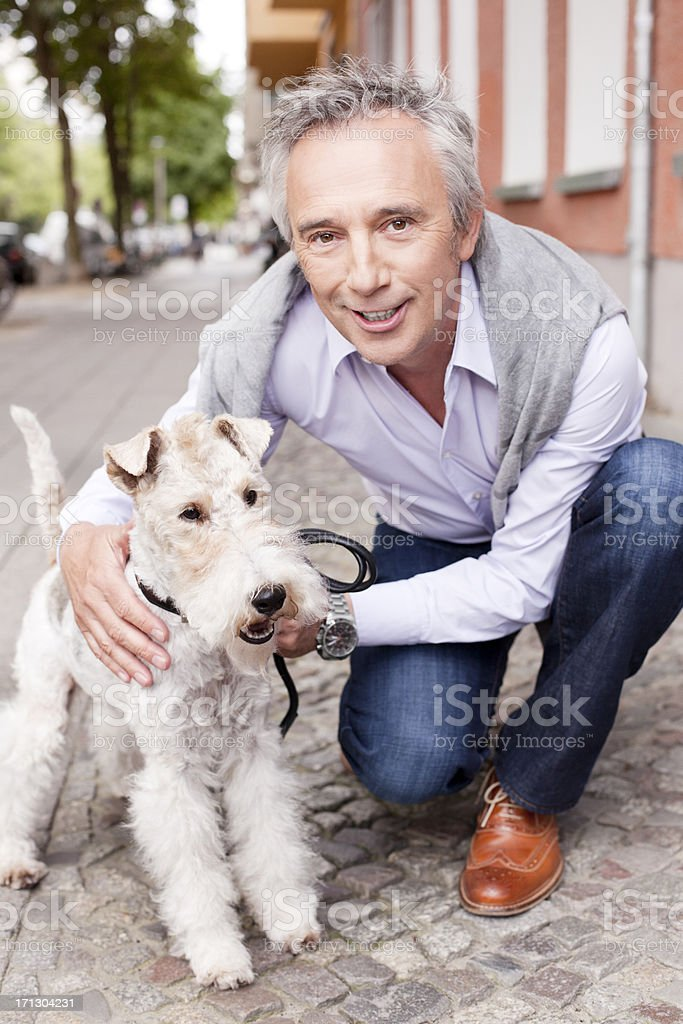 Adult man with his fox terrier dog pet royalty-free stock photo