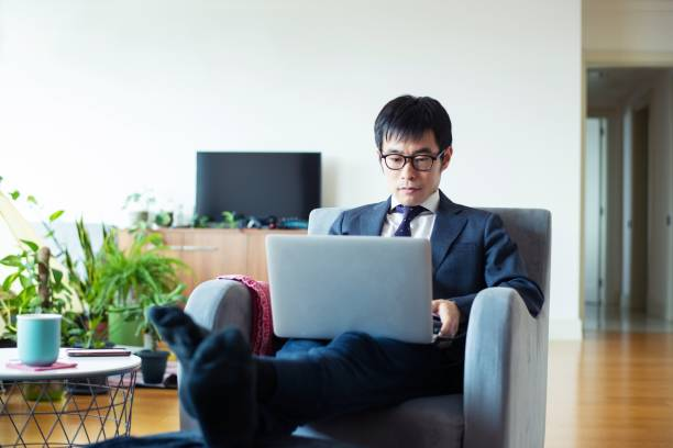 Adult man working from home stock photo