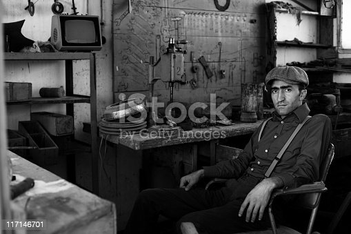 istock Adult man working in old fashined garage 117146701