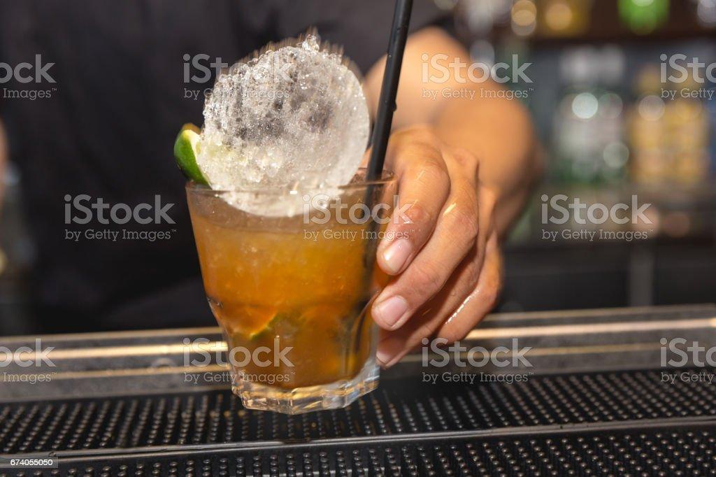 Adult men holding caipiroska on bar stock photo