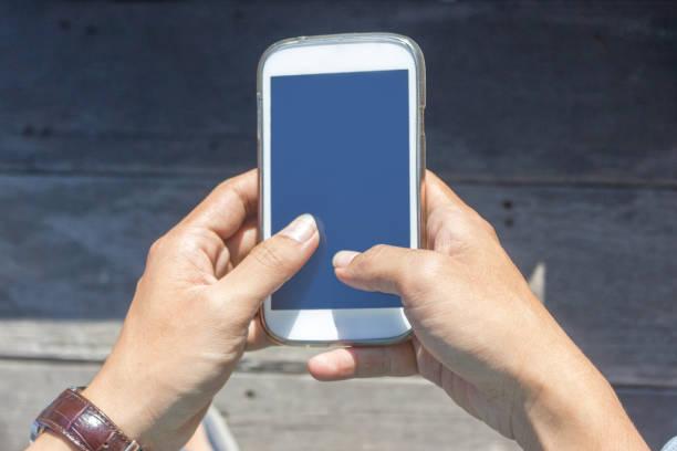 Adult men text messaging friends stock photo
