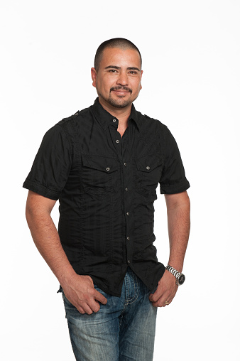 Adult Mexican man against white background