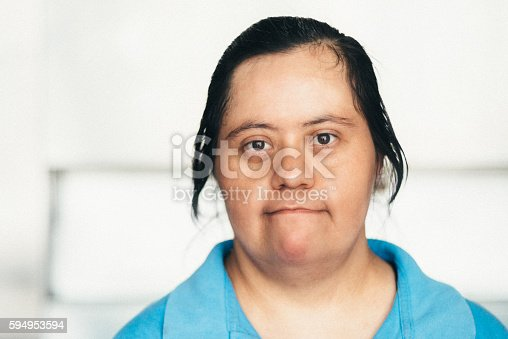 594475880istockphoto Adult Mexican woman with down syndrome 594953594