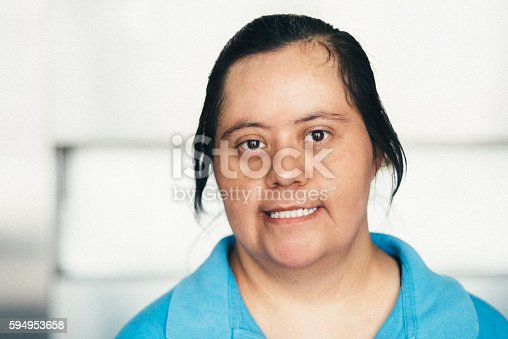 594475880istockphoto Adult Mexican woman with down syndrome 594953658