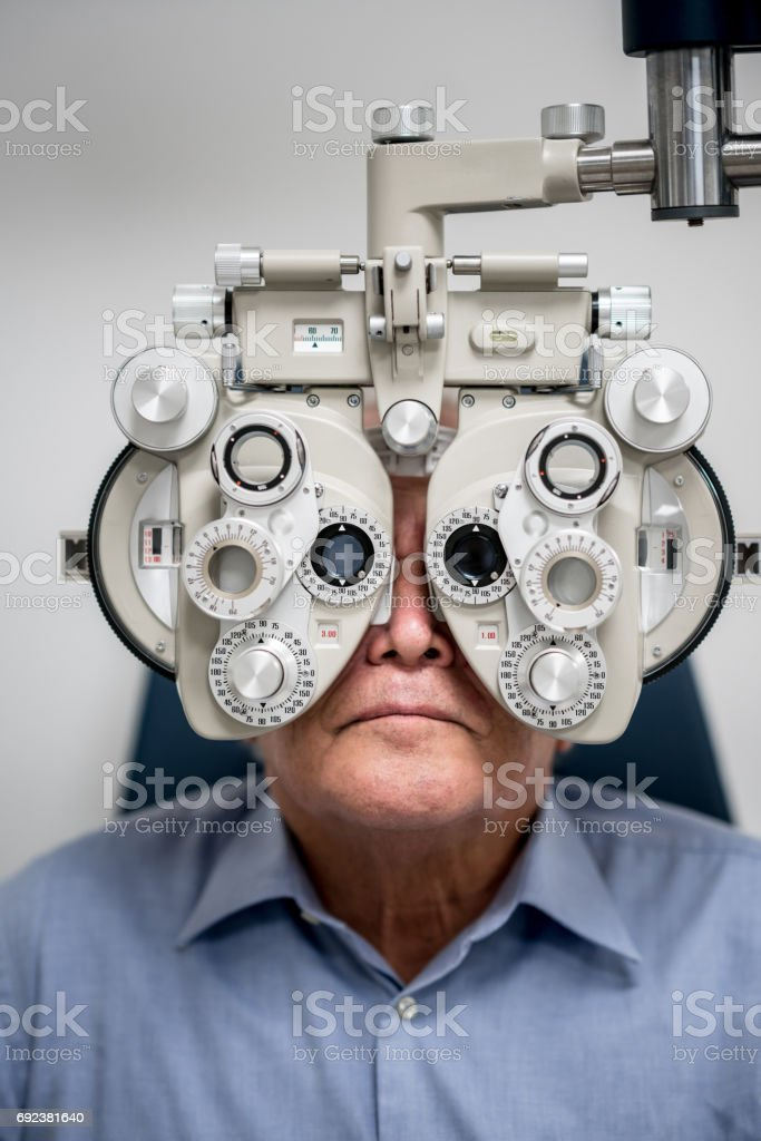 Adult patient getting an eye exam at the optician stock photo