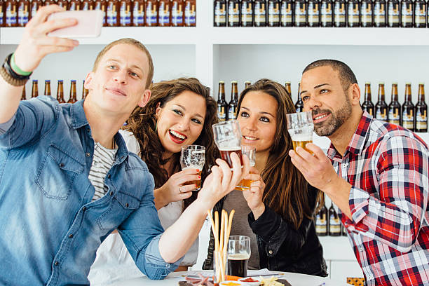 Adult people with craft beer taking selfie stock photo