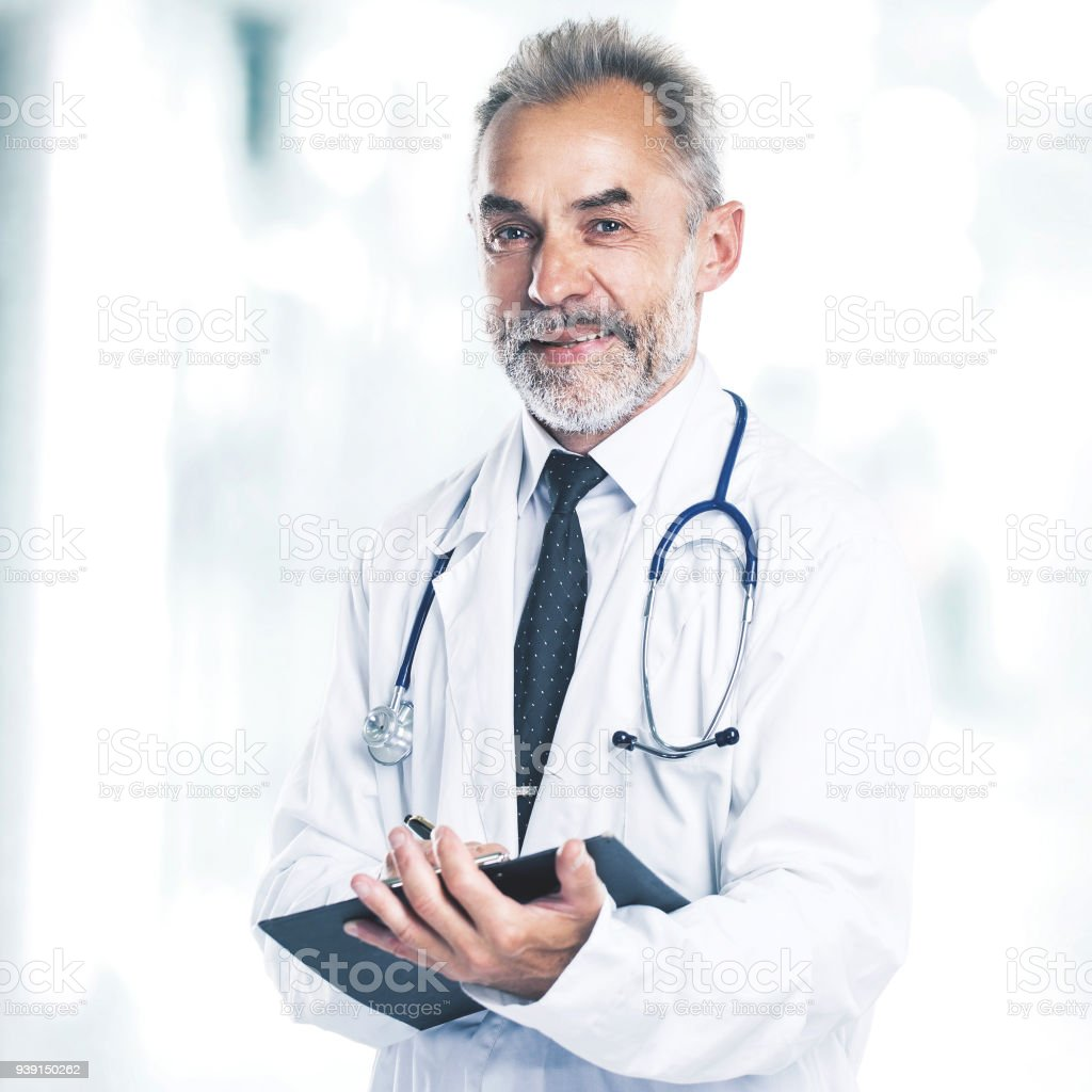 Adult qualified physician diagnostician, with a stethoscope stock photo