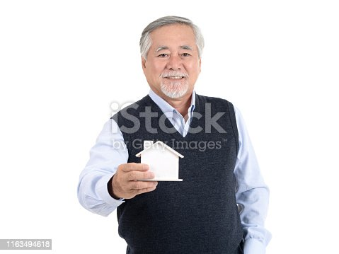 istock Adult senior old man hold house with copy space for your promotional or text isolated on white background ,Property investment and mortgage financial concept. 1163494618