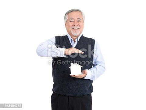 1145921132istockphoto Adult senior old man hold house with copy space for your promotional or text isolated on white background ,Property investment and mortgage financial concept. 1163494761