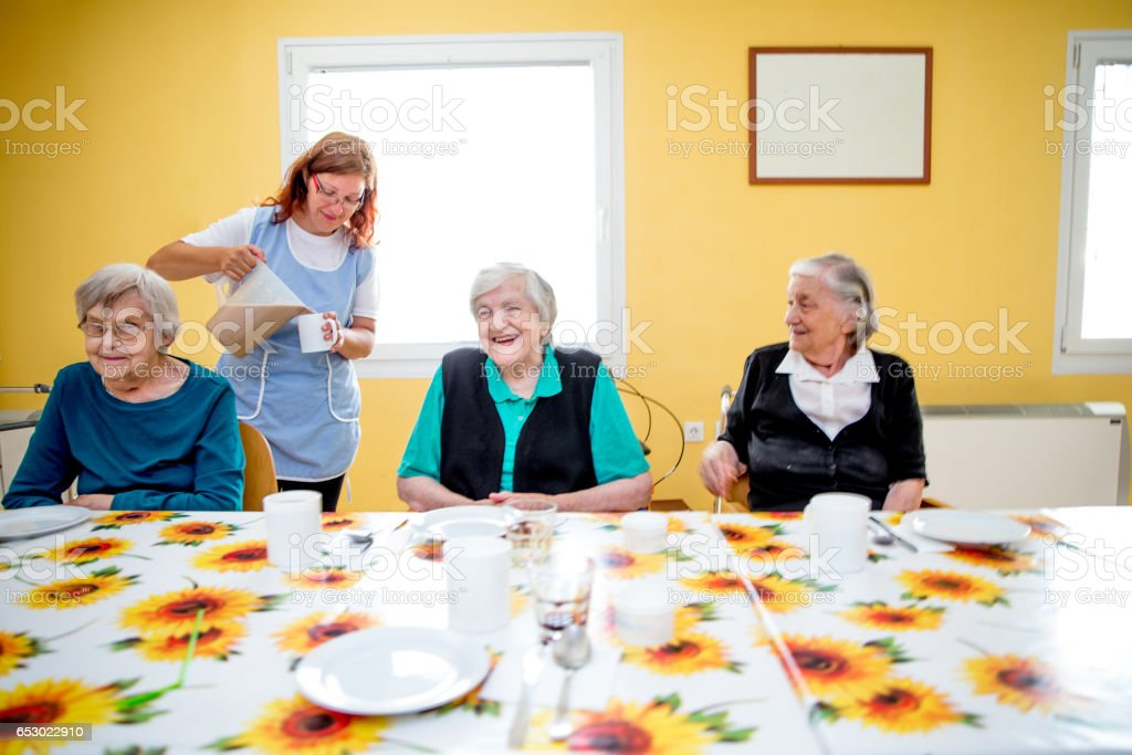 Adult Seniors Having Breakfast At The Care Center stock photo