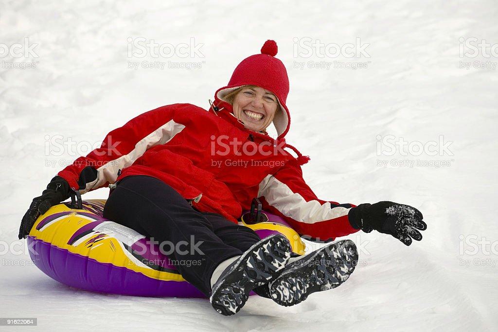 Adult Sledding stock photo