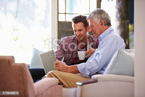 istock Adult Son Helping Senior Father With Computer At Home 475946970