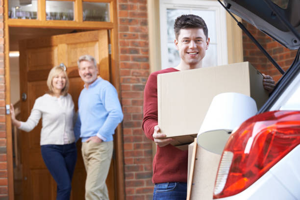 adult son moving out of parent's home - leaving stock photos and pictures