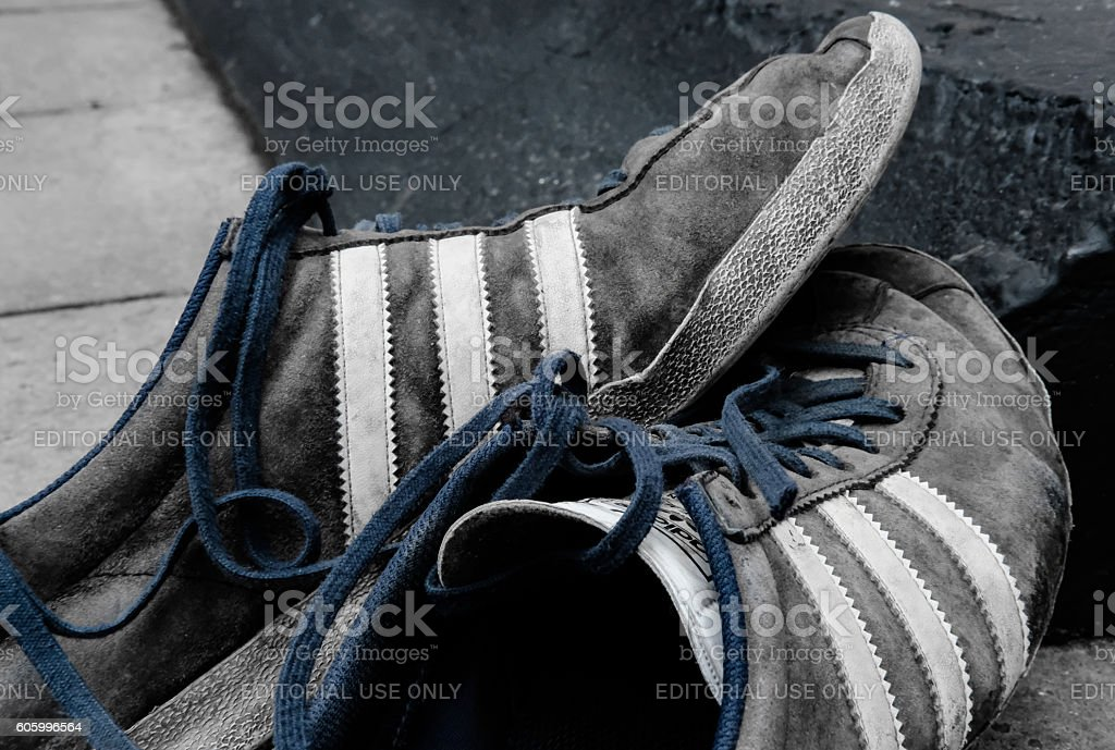 Adult sport training shoes in worn condition stock photo