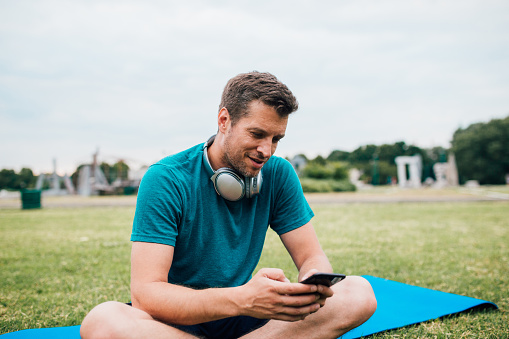 istock Adult sportsman searching for song 1196340071