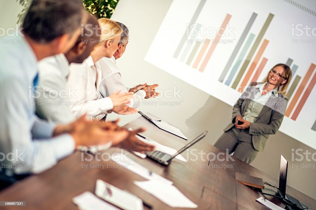 Adult Students Applauding Great Presentation at a Conference royalty-free stock photo