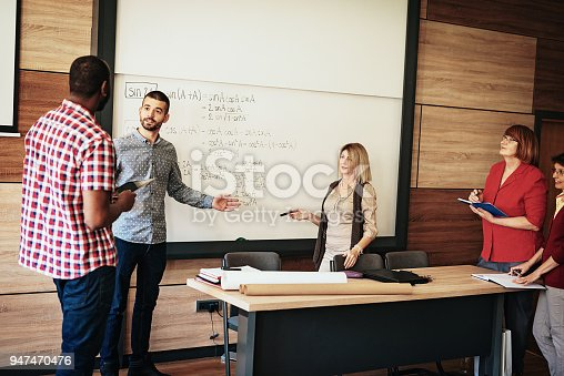956725740istockphoto Adult students debating 947470476