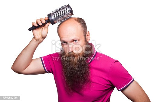 istock Adult unhappy man hand holding comb on bald head 586347942