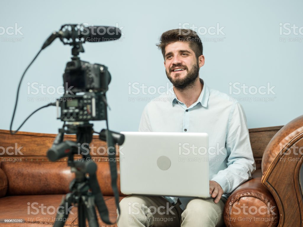Adult Video Blogger Talking In Front Of Camera stock photo