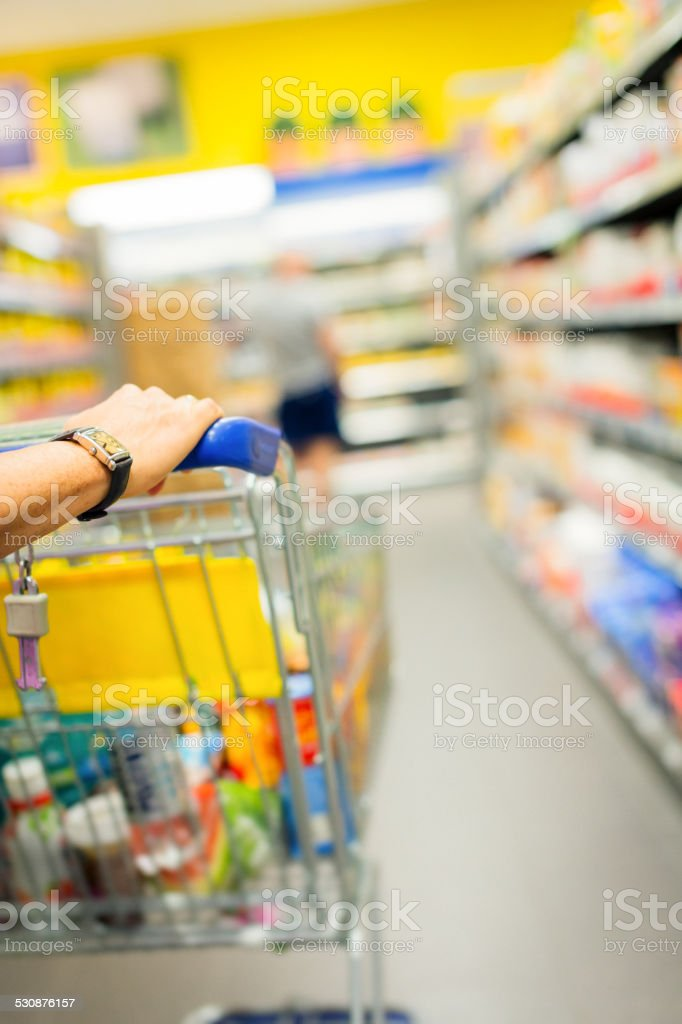 adult woman at the supermarket stock photo