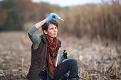 Adult Woman Biologist Examining Rain Water on an Agricultural Field