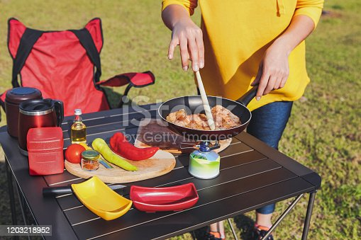 Adult Woman Cooking a Meal in Nature