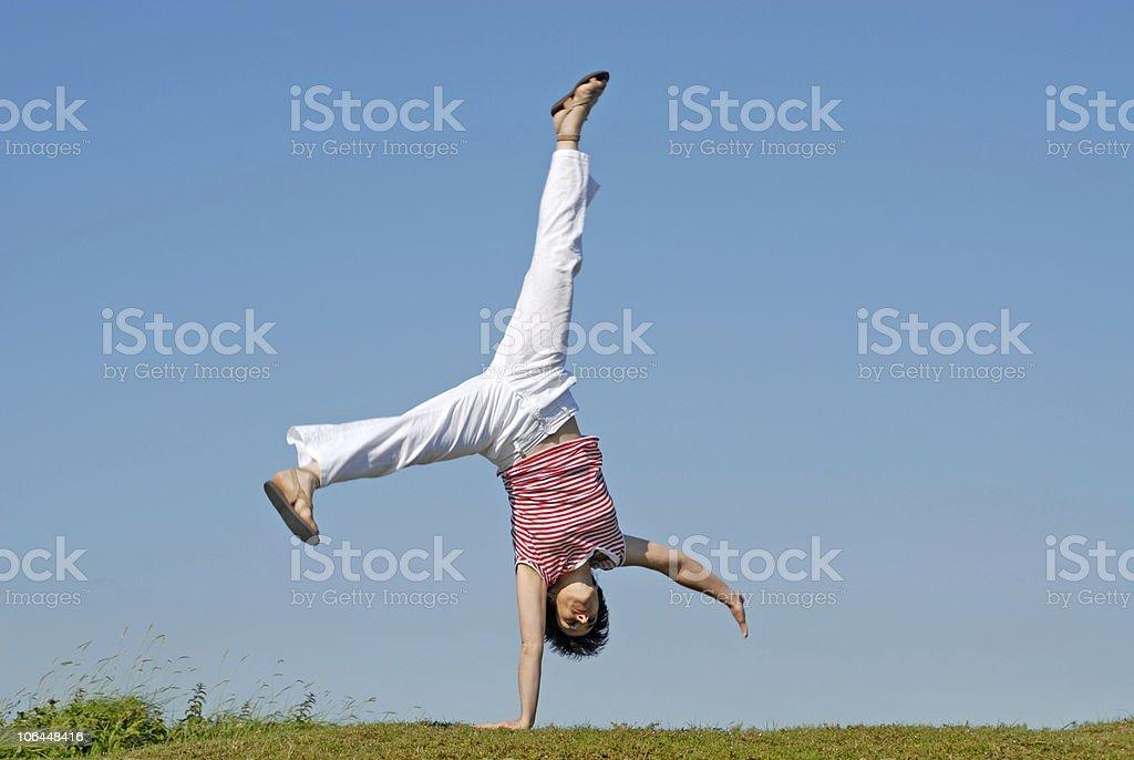 Adult woman doing gymnastics stock photo