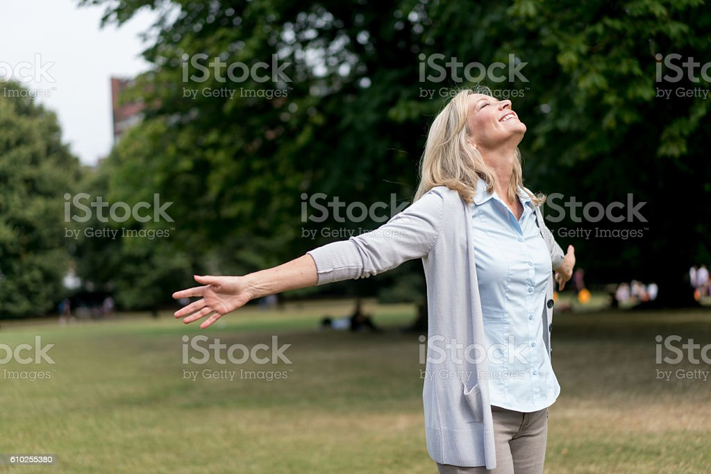 Adult woman enjoying her time at the park stock photo