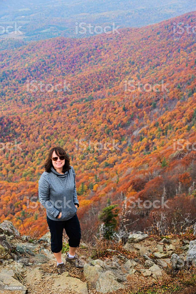 XXXL: Adult woman enjoying the colors of autumn stock photo