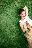istock Adult Woman Enjoying Time with Pet Dog 484151450