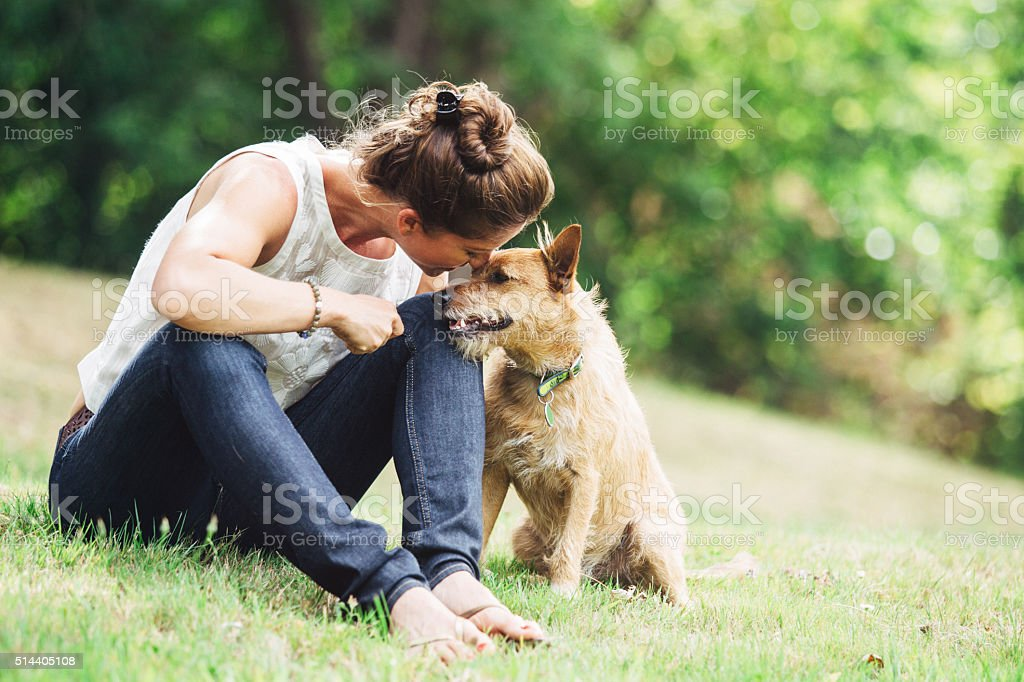 Adult Woman Enjoying Time with Pet Dog bildbanksfoto