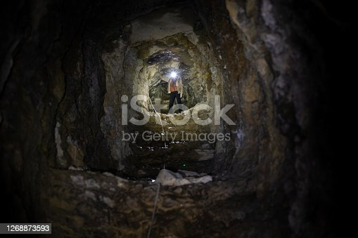 Adult Woman Exploring Artificial Tunnel Caverns From World War in Europe.