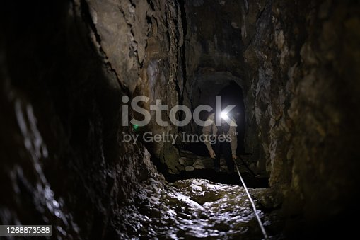 Adult Woman Exploring Caverns From World War in Europe.