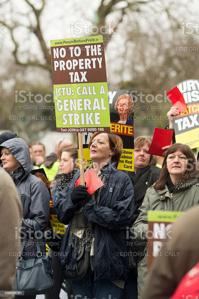 Adult woman expresses her thoughts about new property tax royalty-free stock photo