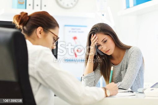 istock Adult woman having a visit at female doctor's office 1061399208